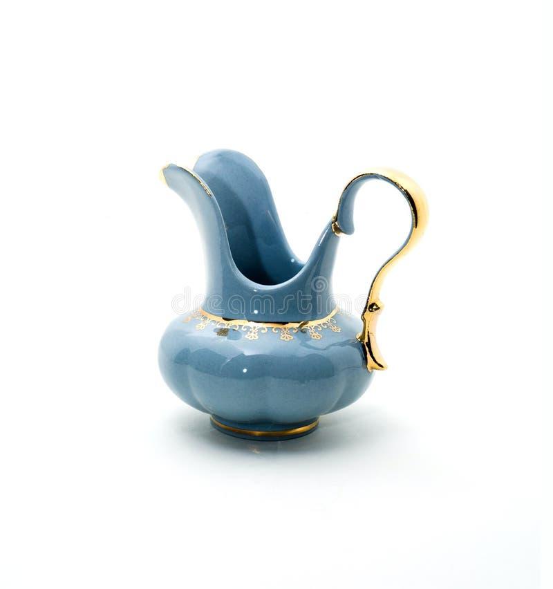 Frasco da porcelana com um teste padrão do ouro imagem de stock royalty free