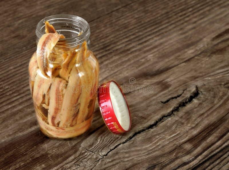 Frasco das anchovas no azeite fotografia de stock royalty free