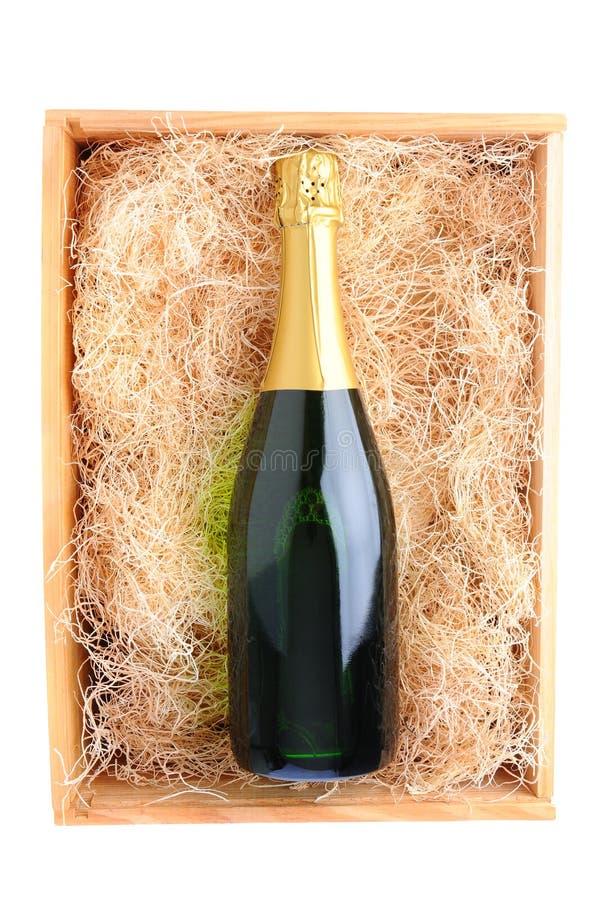 Frasco de Champagne na caixa de madeira fotografia de stock