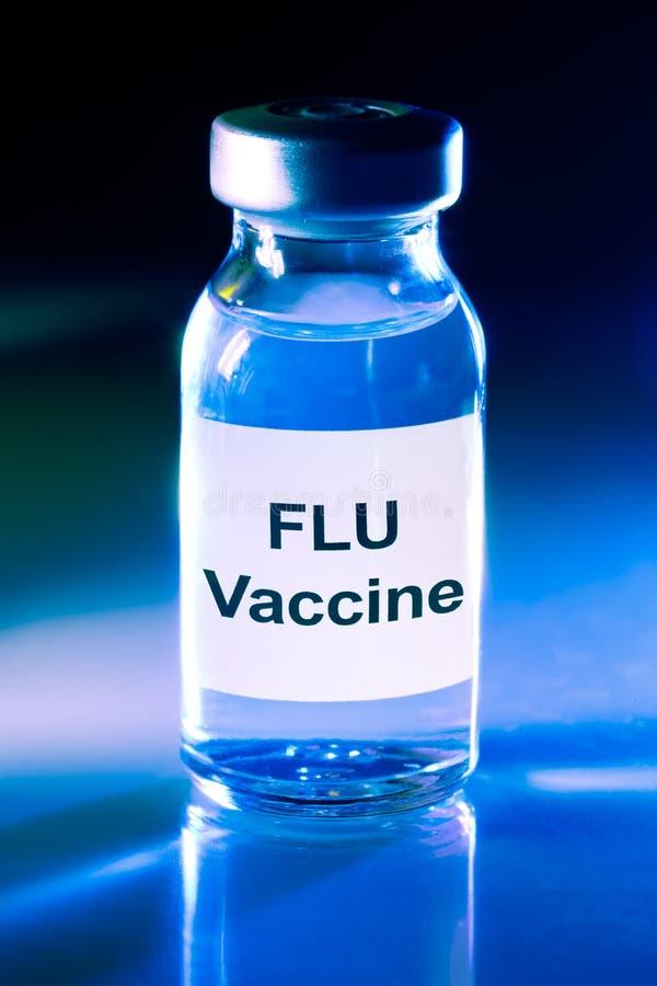 Frasco de la droga con la vacuna de la gripe fotos de archivo libres de regalías