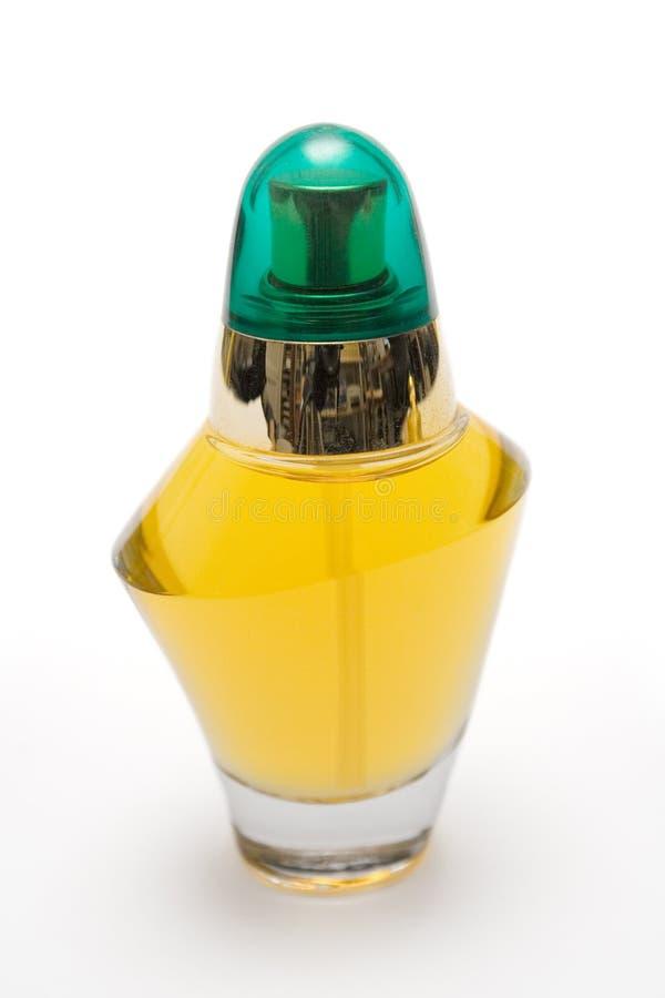 Frasco de perfume com tampão verde imagem de stock