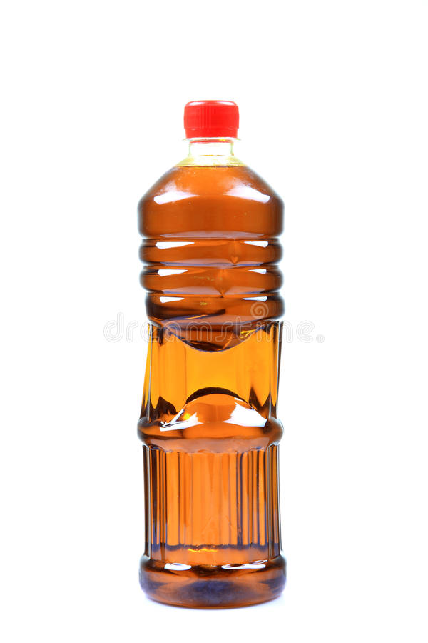 Frasco de petróleo da mostarda fotografia de stock royalty free