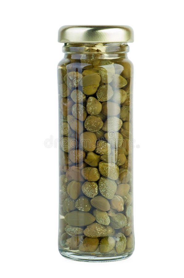 Frasco de vidro com alcaparras postas de conserva fotos de stock