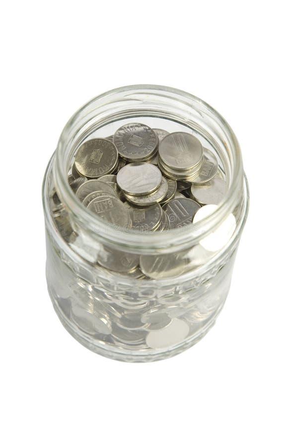 Frasco de vidro com moedas de prata fotos de stock royalty free