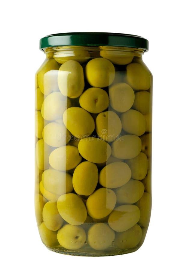 Frasco de vidro de azeitonas preservadas fotografia de stock