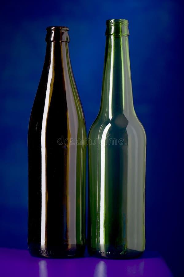 Frasco de vidro no azul imagens de stock