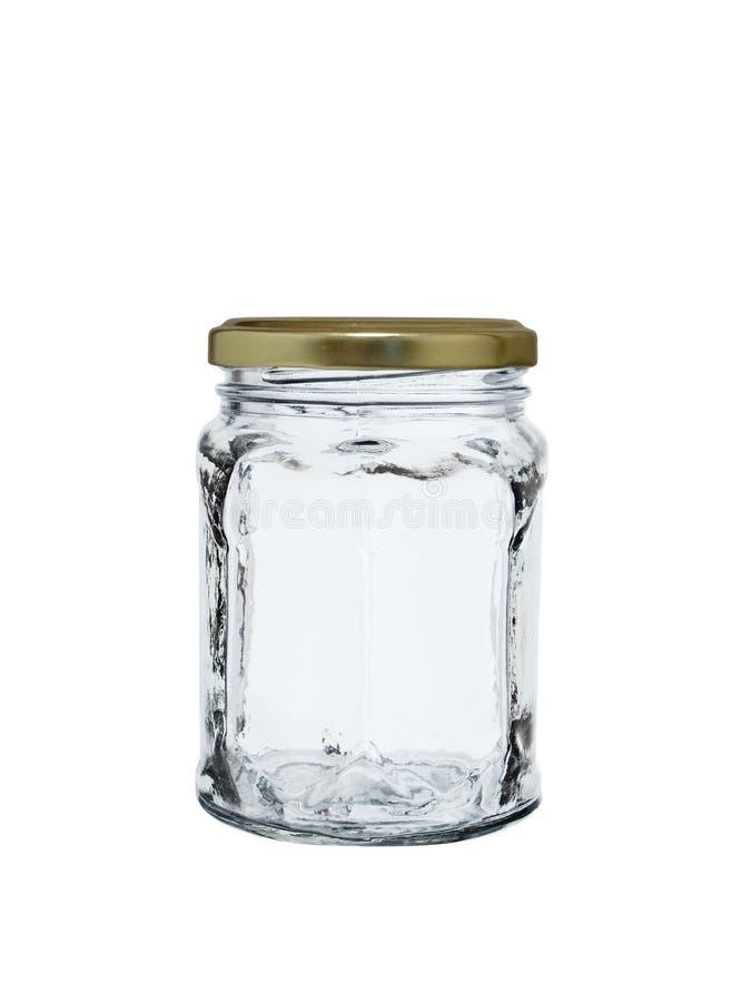 Frasco de vidro vazio com uma tampa do ferro isolada em um fundo branco imagens de stock royalty free