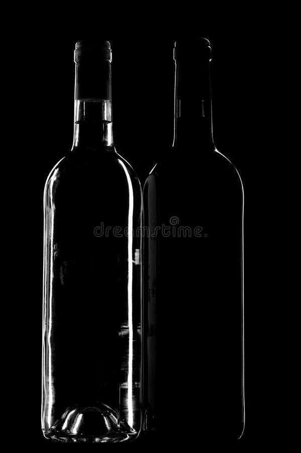 Frasco de vinho dois no preto fotografia de stock royalty free