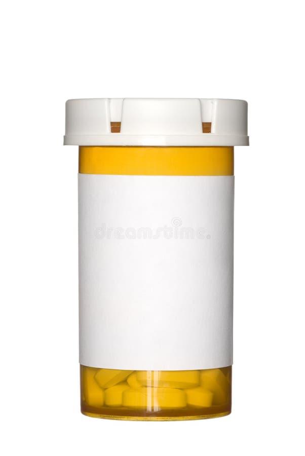 Frasco do comprimido no fundo branco imagem de stock