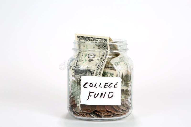 Frasco do dinheiro do fundo da faculdade fotografia de stock