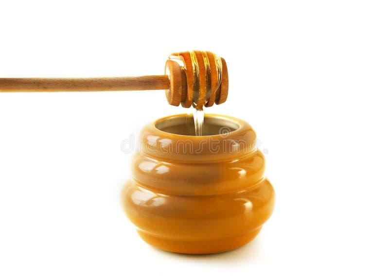 Frasco do mel com drizzler fotografia de stock