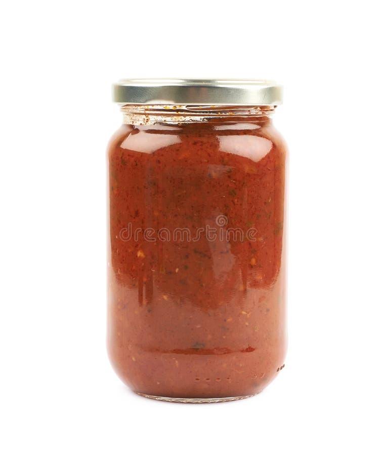 Frasco do molho de tomate do marinara isolado fotografia de stock royalty free