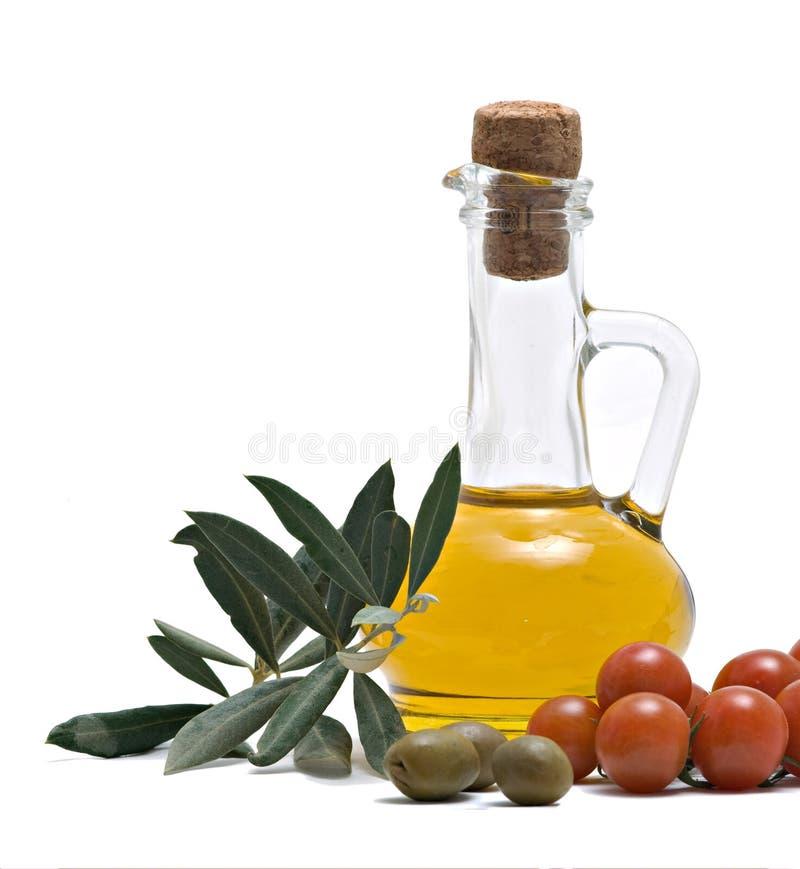 Frasco do oi verde-oliva, dos tomates, e de frutas verde-oliva fotos de stock