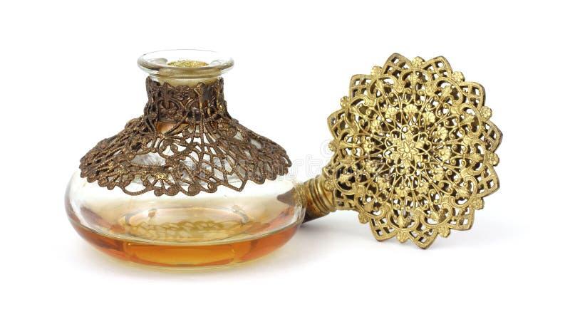 Frasco e bujão muito velhos de perfume fotografia de stock