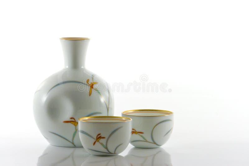 Frasco e copos da causa fotografia de stock royalty free