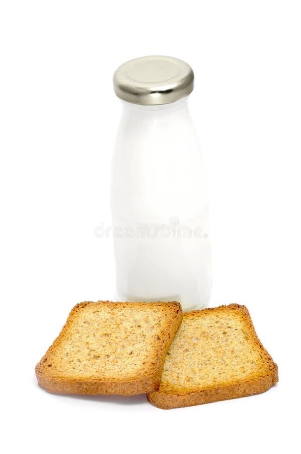 Frasco e pão de leite imagem de stock