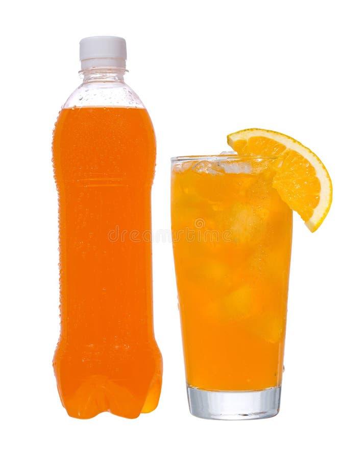Frasco e vidro com bebida alaranjada imagem de stock royalty free