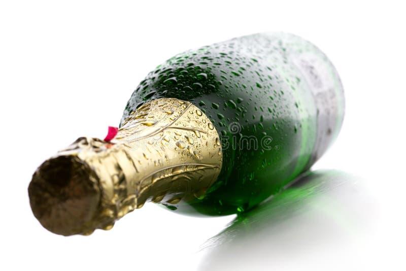 Frasco molhado de Champagne fotografia de stock