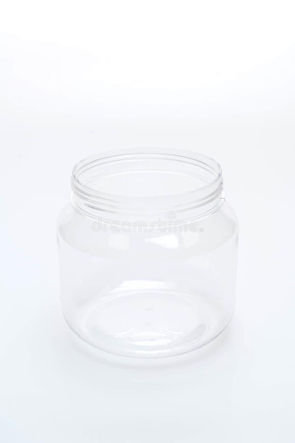 frasco plástico vazio no fundo branco imagens de stock