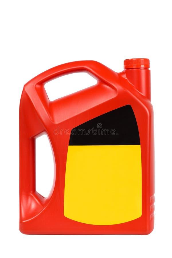 Frasco plástico vermelho do petróleo de motor foto de stock