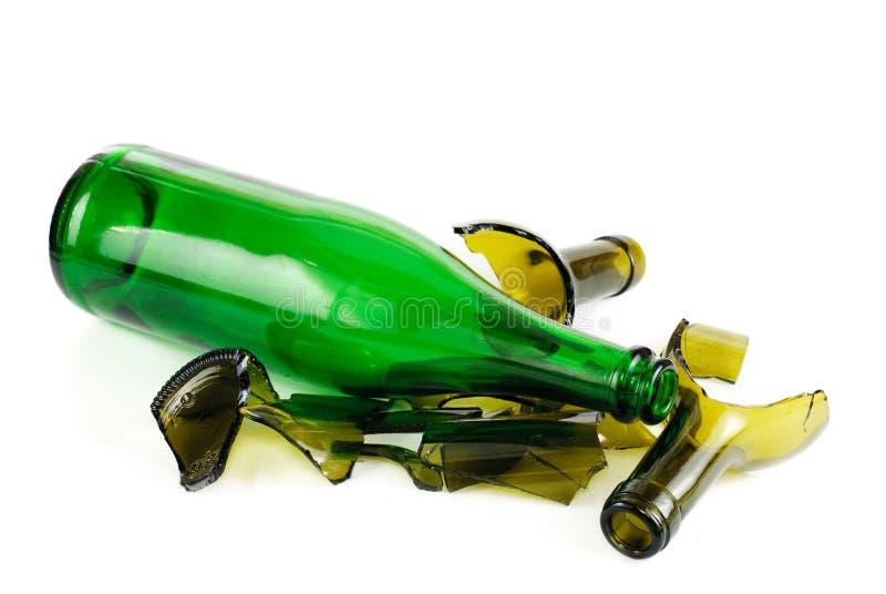 Frasco verde inteiro e quebrado imagem de stock
