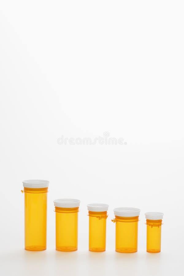 Frascos amarelos vazios da medicina. Isoated fotos de stock