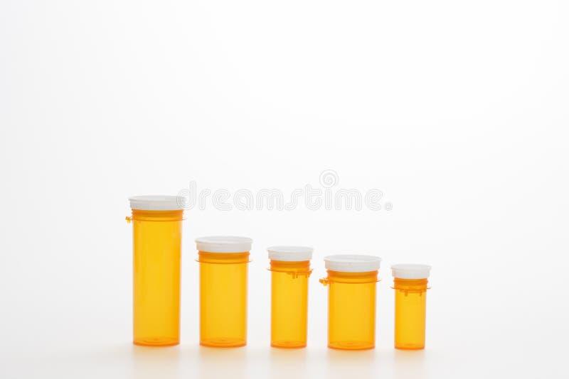 Frascos amarelos vazios da medicina. Isoated imagem de stock