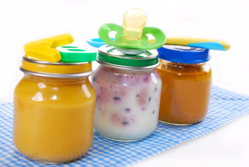 Frascos com comida para bebê fotografia de stock