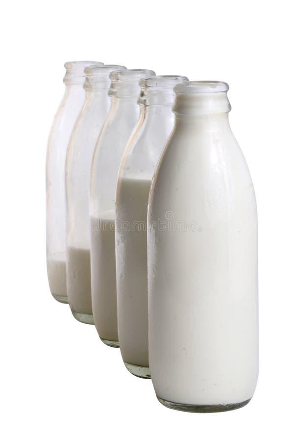 Frascos de leite imagem de stock royalty free