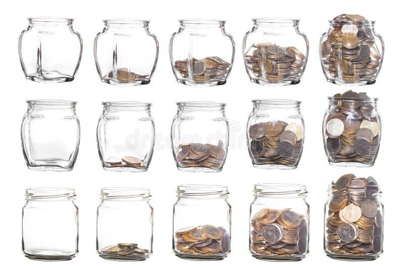 Frascos de vidro com as moedas como o diagrama isolado no fundo branco fotografia de stock royalty free