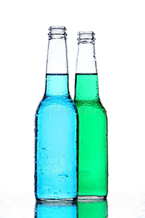 Frascos do álcool no branco imagem de stock