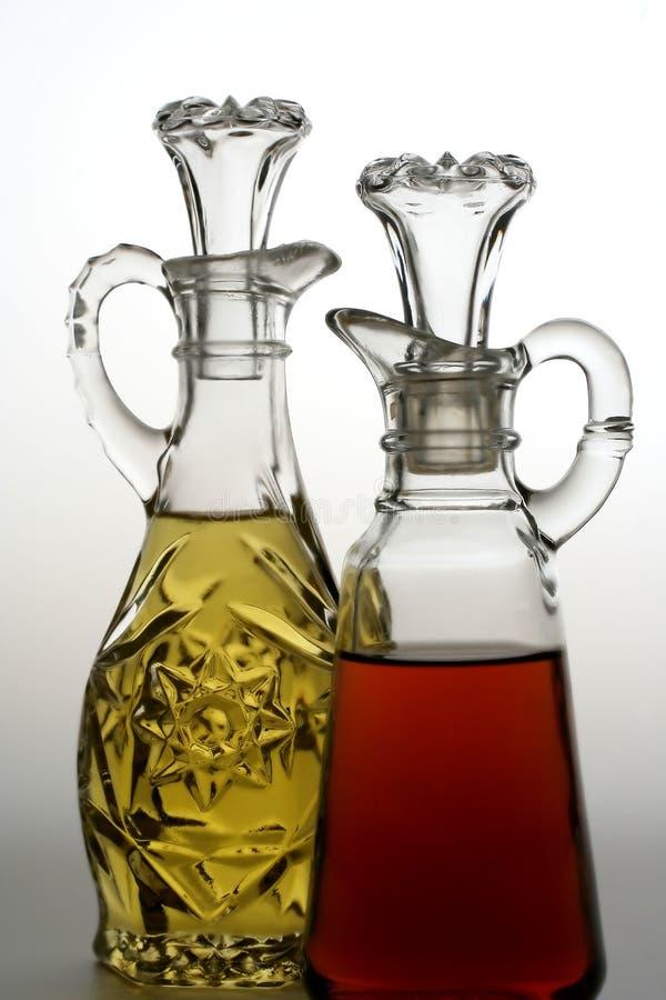 Frascos do petróleo e do vinagre foto de stock royalty free