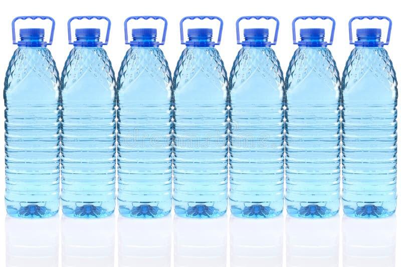 Frascos plásticos da água mineral imagens de stock royalty free