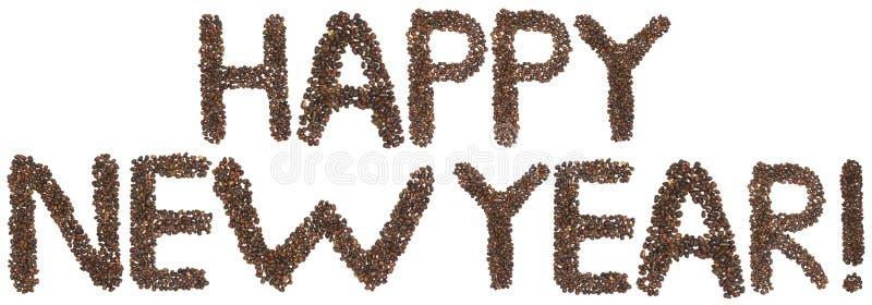 Frase de la Feliz Año Nuevo hecha de nueces de cedro imágenes de archivo libres de regalías