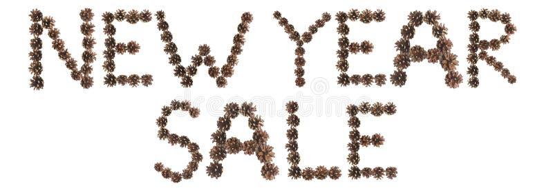 Frase de la venta del Año Nuevo hecha de cono del pino foto de archivo libre de regalías