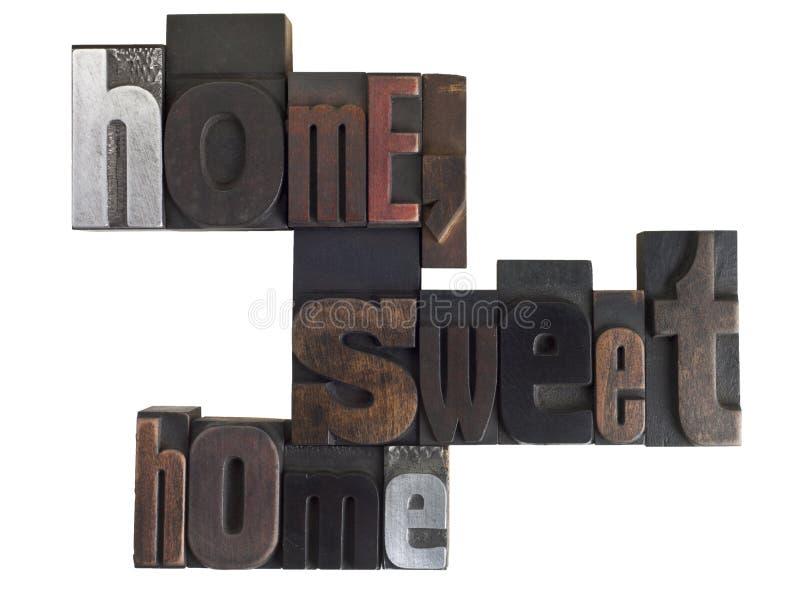Frase della casa dolce casa nel tipo dello scritto tipografico immagine stock
