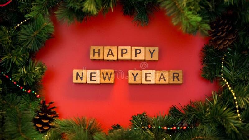 Frase hecha de cubos, celebración de los días de fiesta, calendario del este de la Feliz Año Nuevo imagen de archivo