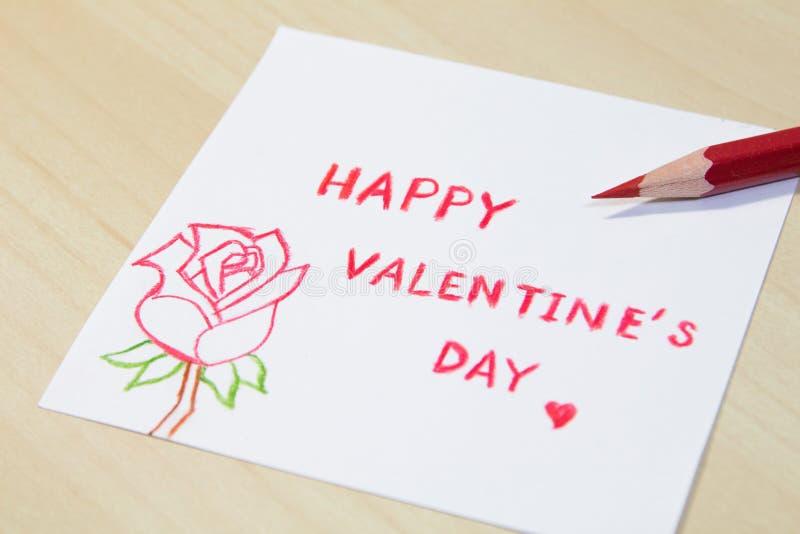 Fraseología feliz del día de tarjeta del día de San Valentín con el lápiz del color imagen de archivo