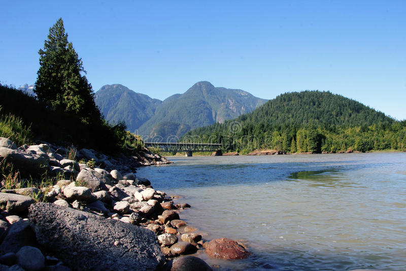 The Fraser Bridge. Stretching across the Fraser River near Hope BC royalty free stock photography