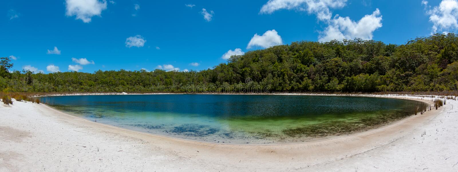 An empty, peaceful and beautiful lake on Fraser Island. Fraser Island is dotted with many small inland lakes, all of them crystal clear water and perfect white stock photos