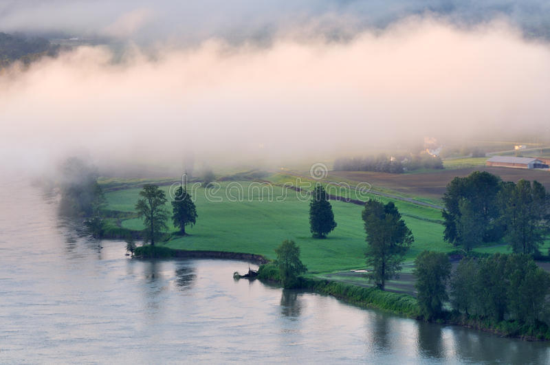 Fraser river at foggy sunrise. Fraser river near Abbotsford at foggy sunrise, British Columbia, Canada stock photography