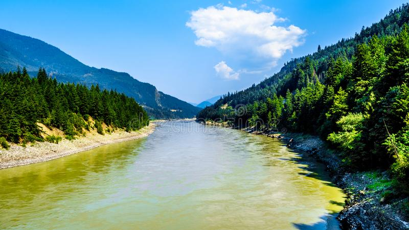 The Fraser River looking north from the Cog Harrington Bridge in the Fraser canyon in BC Canada. The Fraser River looking north from the Cog Harrington Bridge royalty free stock photography