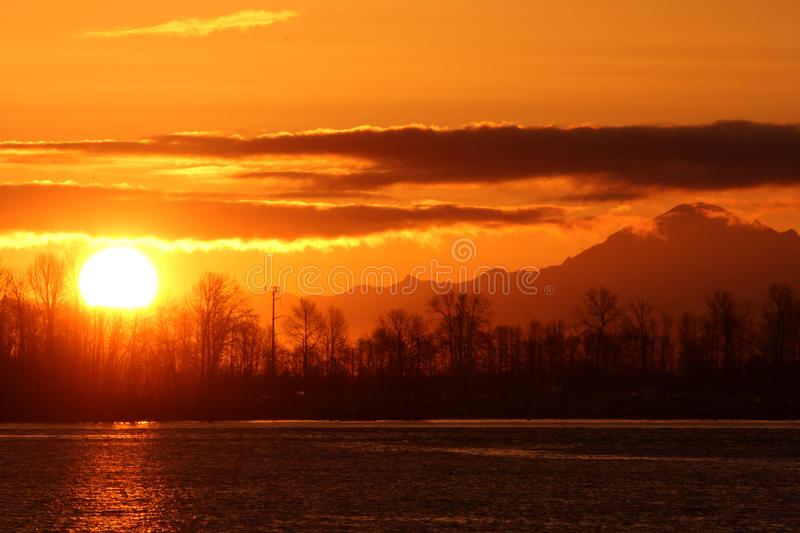 Fraser River, Mount Baker Sunrise. Sunrise over the Fraser River beside Washington State's Mount Baker. British Columbia, Canada near Vancouver royalty free stock photo