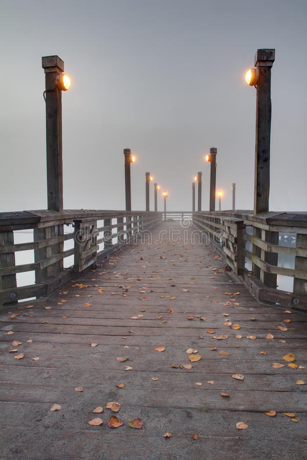 Fraser River Pier, Fog. Fog, off the Fraser River, wraps around a fishing pier in the early morning. British Columbia, Canada royalty free stock image