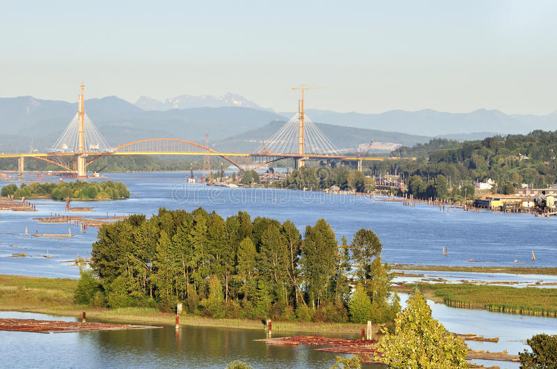 Fraser River view. Fraser River with Trees on an Island and a Bridge under Construction, british columbia royalty free stock photos