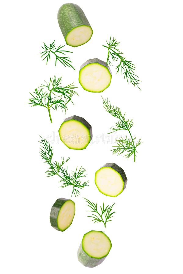 Frash falling zucchini and dill herb isolated on white stock image