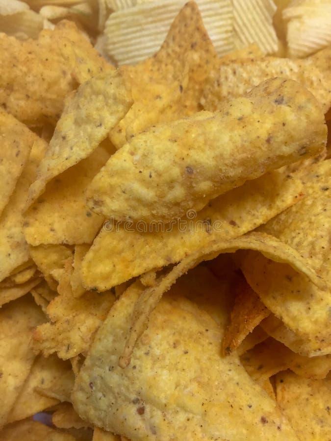 Frasiga guld- nachos royaltyfri fotografi