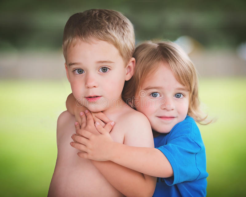 Fraternal Twins Love. 3 year old fraternal twins showing some love royalty free stock photo