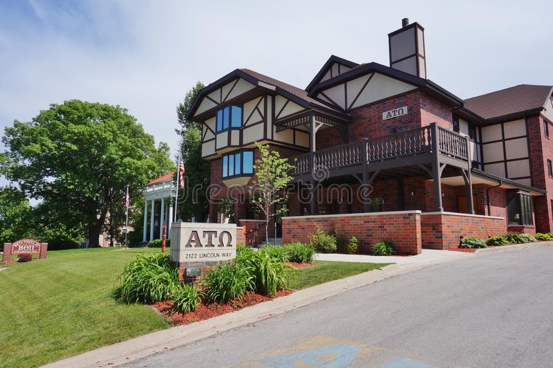 Fraternity and sorority houses at Iowa State University. AMES, IA - Fraternity and sorority houses with Greek letters on the campus of Iowa State University (of stock image