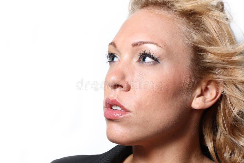 Frau auf einem weißen Hintergrund lizenzfreies stockfoto